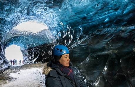 Person exploring an ice cave